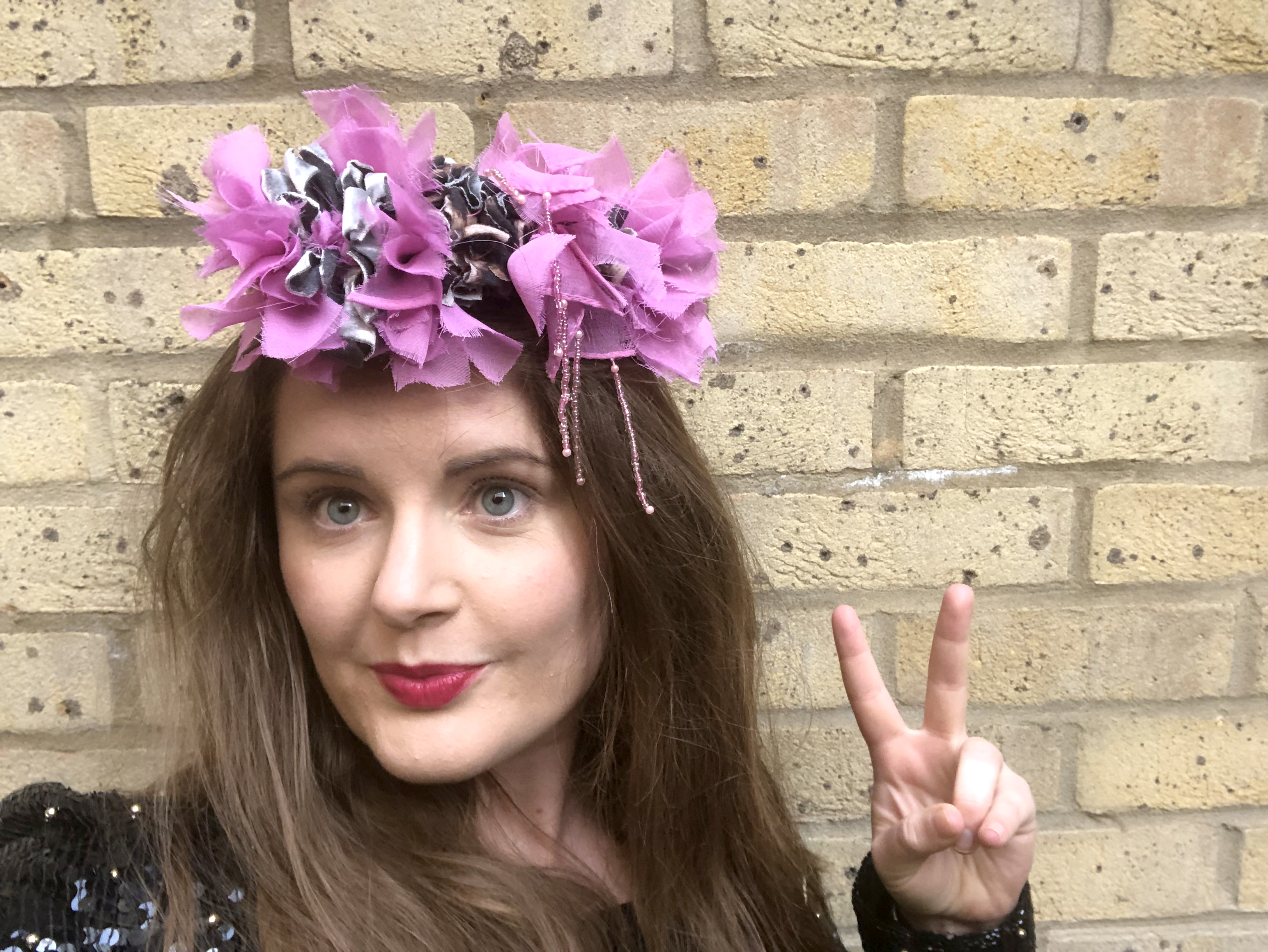 Elspeth Jackson from Ragged Life modelling a pink punk rag rug headband made using recycled materials