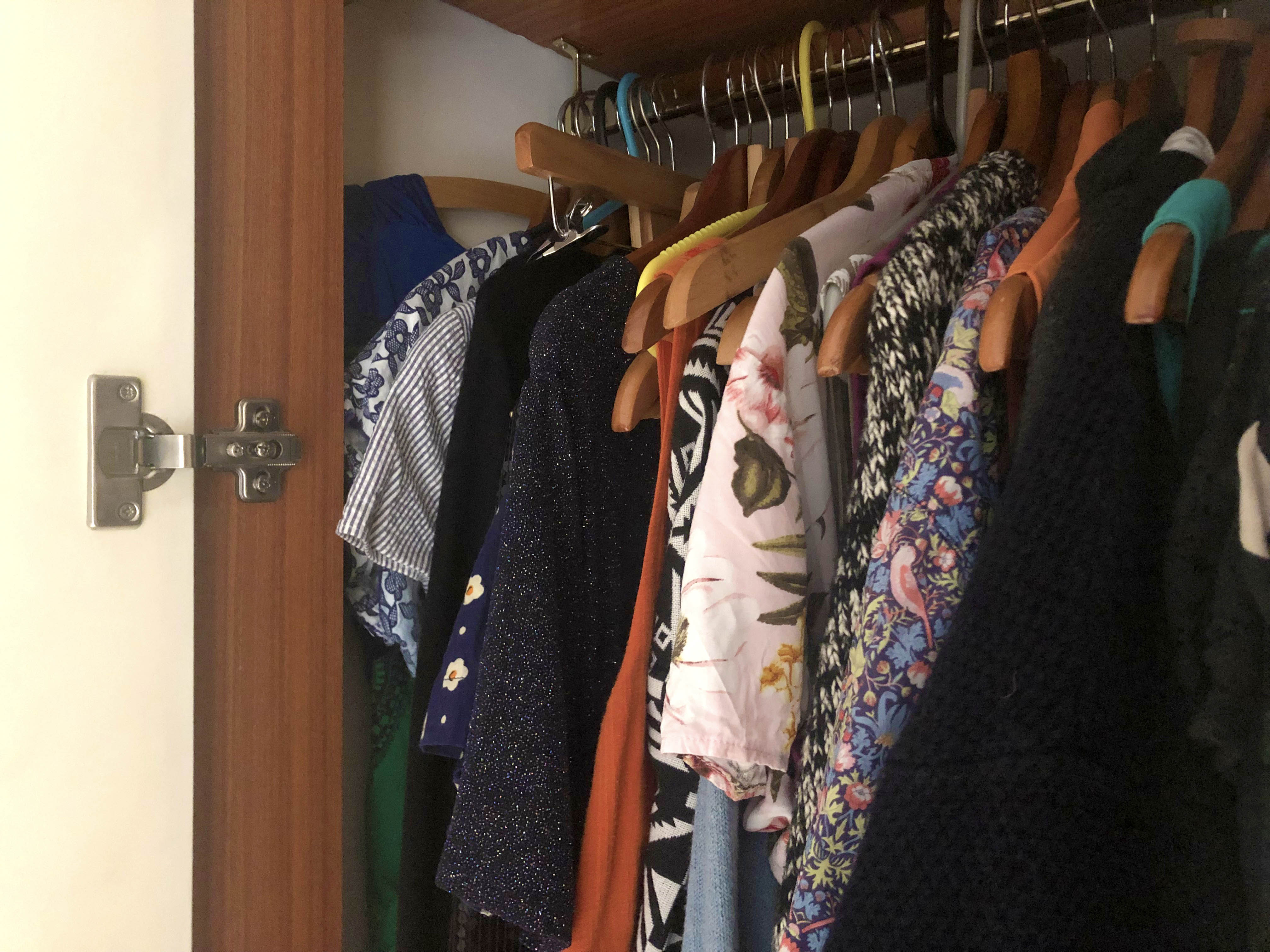 Old clothing in wardrobe used for rag rugging