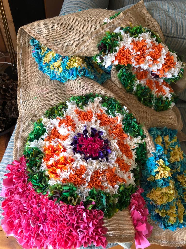 Making a handmade rag rug from old clothing and texile waste