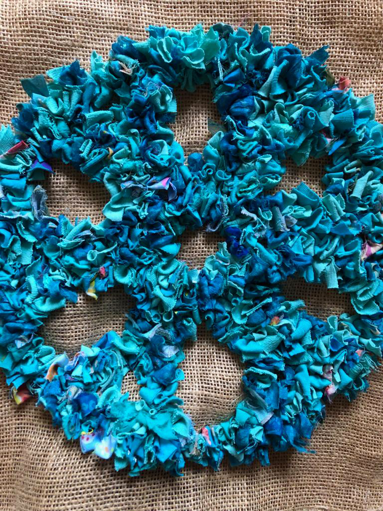 Blue partially made rag rug