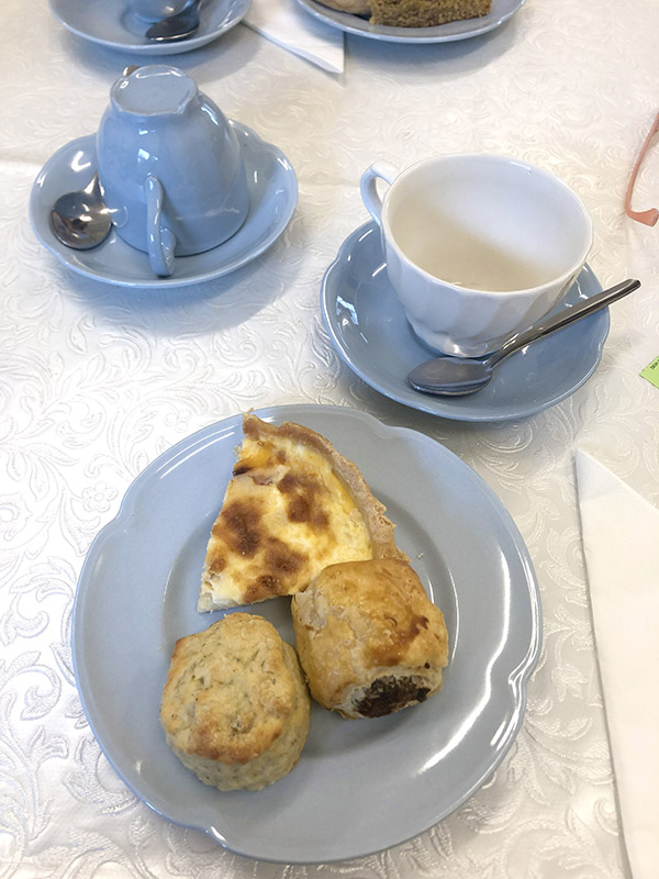 Savoury snacks at afternoon tea in Blindcrake with blue china and quiche