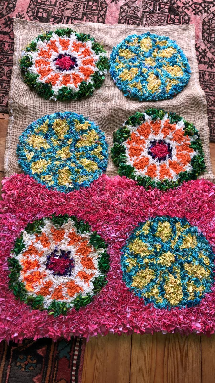 Work in progress half finished pink rag rug with circular geometric design