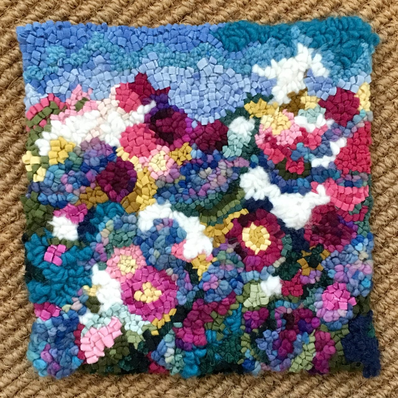 Colourful floral hooked artwork
