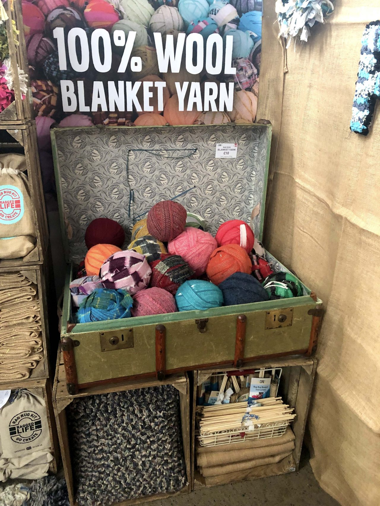Ragged Life rag rug stand at Woolfest 2019 in Cockermouth, Cumbria festival with balls of multicoloured blanket yarn