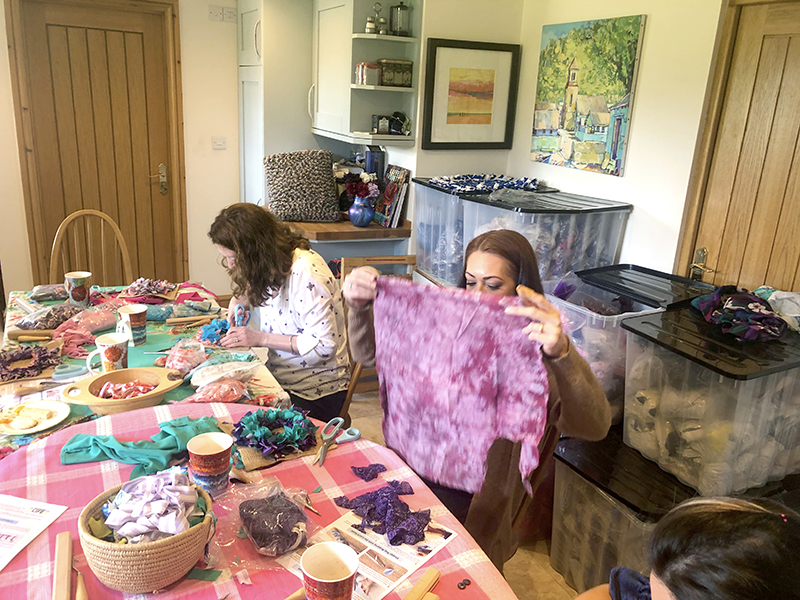Cutting up fabric at the Ragged Life rag rug coffee morning