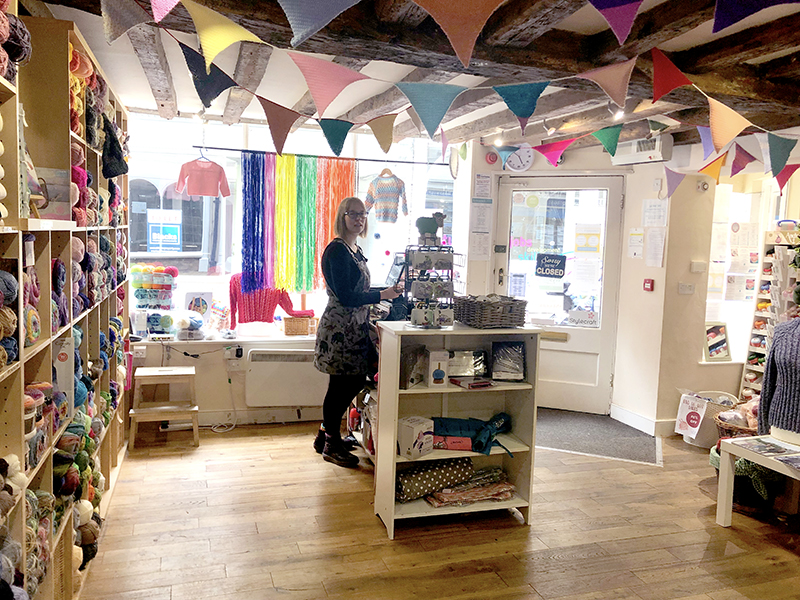 Inside Knit and Stitch Shop in York with knitted bunting