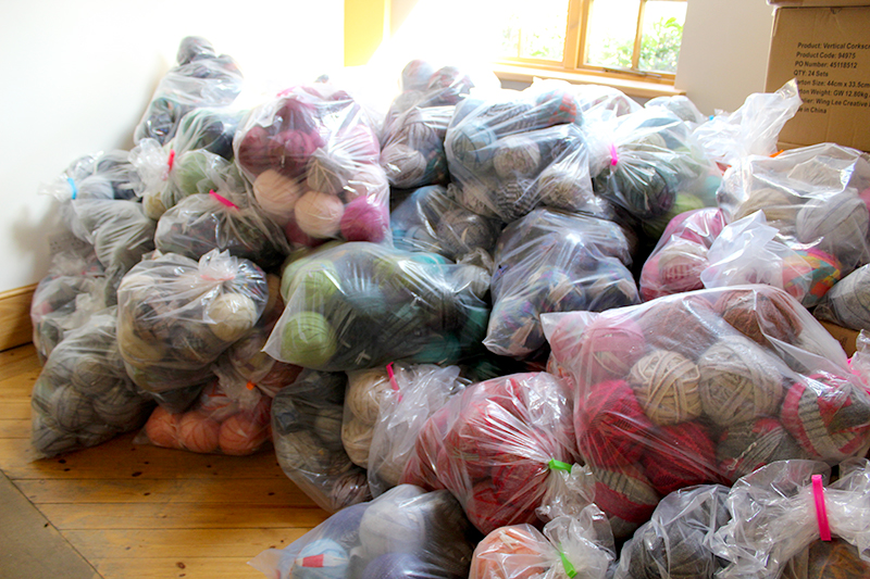 Bags of 100% wool blanket yarn in a pile ready for organising