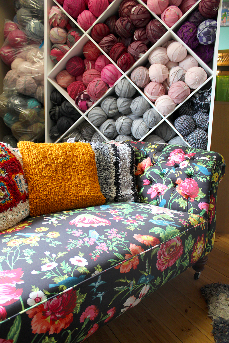 Beautiful craft storage with statement sofa and rag rug cushions
