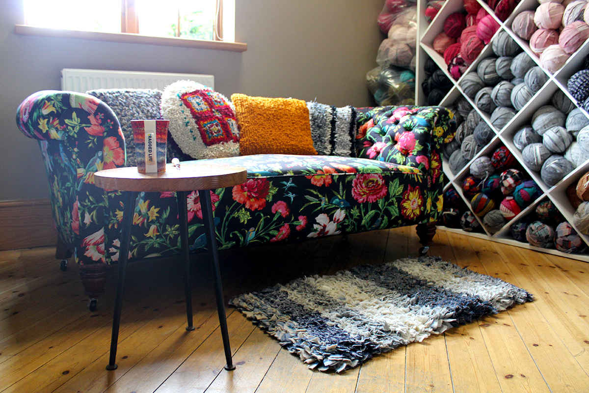 Statement floral sofa with rag rug cushions