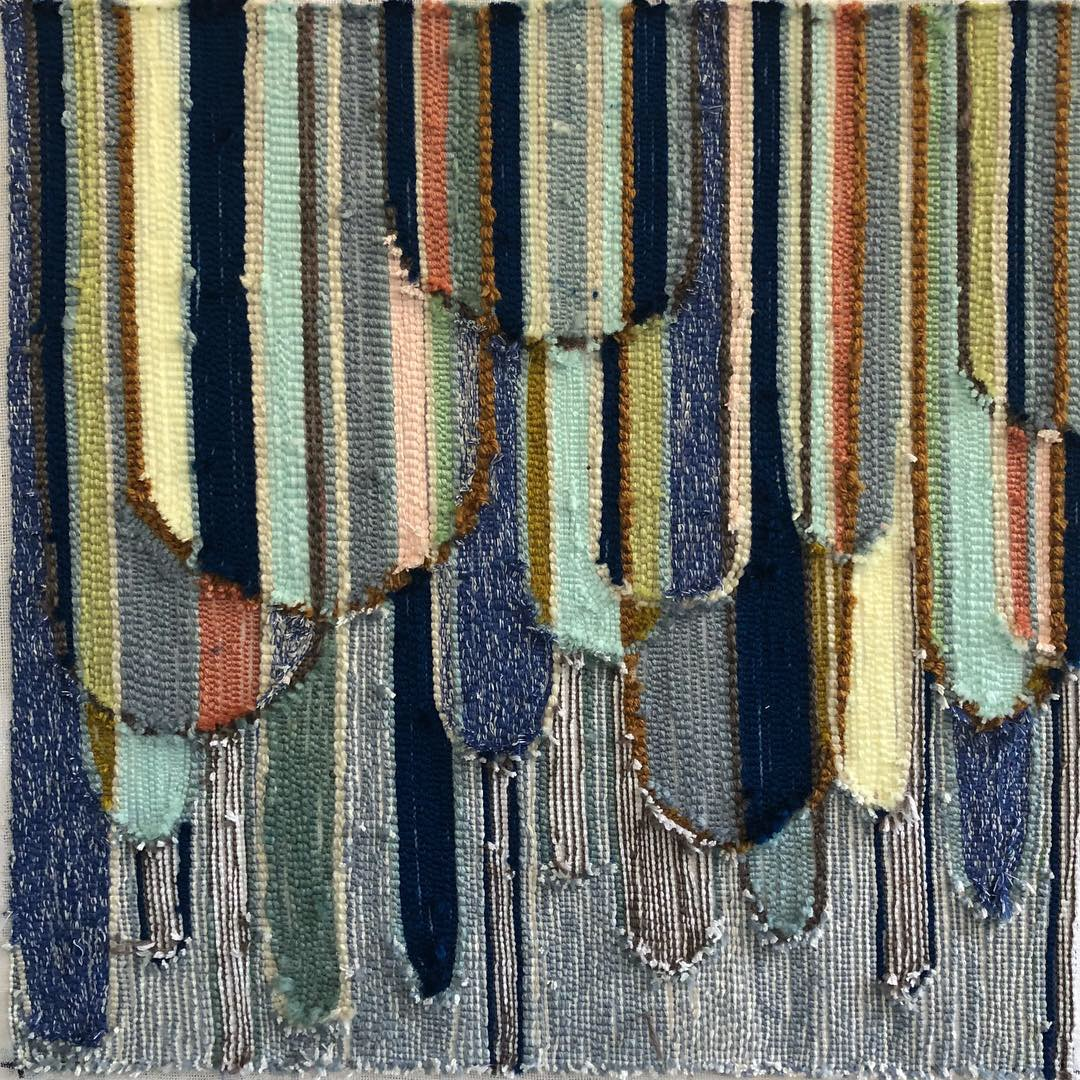 Blue, green and black textile art
