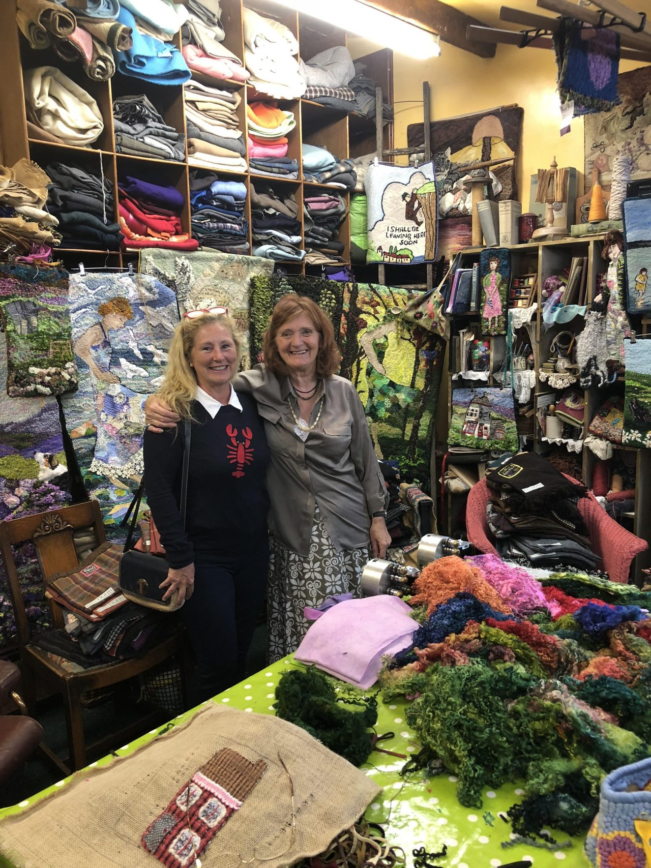 Yvonne Iten-Scott with rug maker Heather Ritchie in Heathers studio packed with fabrics.