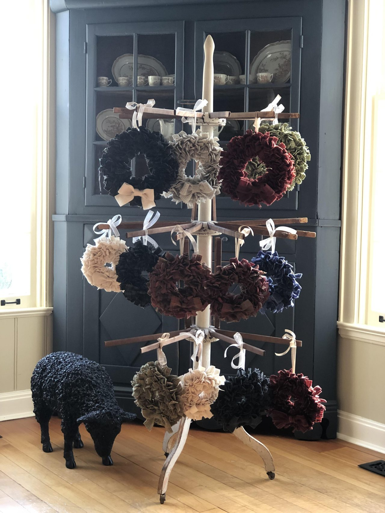 Christmas decoration mini wreaths hanging on a display by Yvonne Iten-Scott