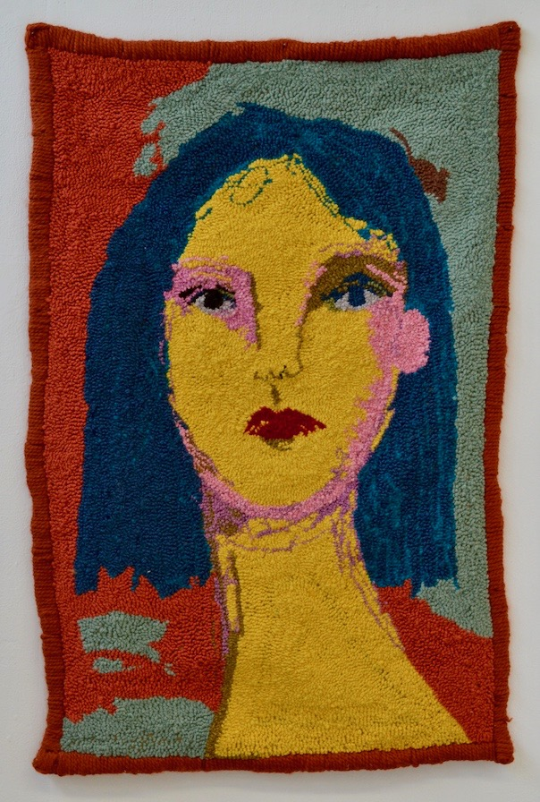 Textile art portrait featuring a woman with yellow skin and blue hair by Selby Hurst Inglefield