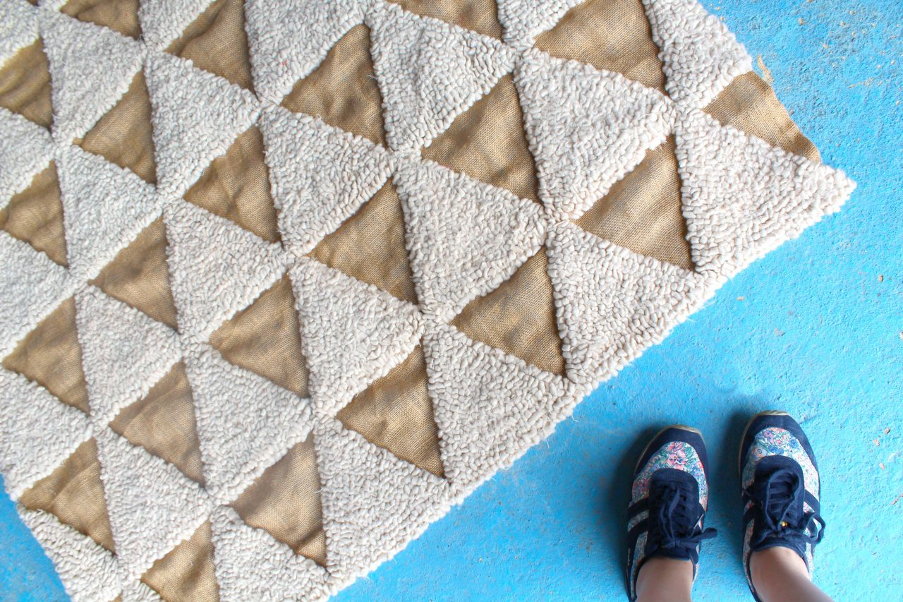 Handmade simple rag rug with triangle geometric design