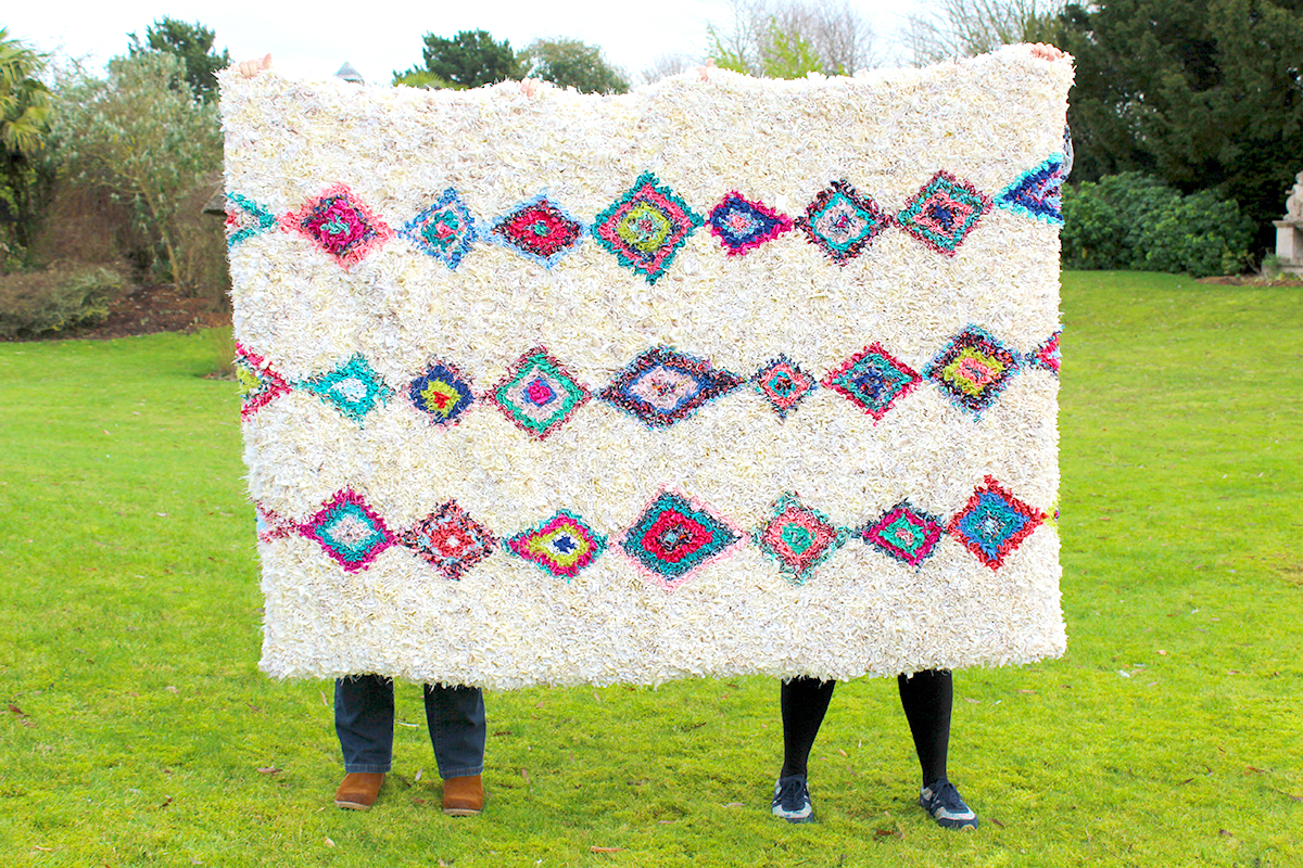 Moroccan Berber style cream rag rug made using recycled materials