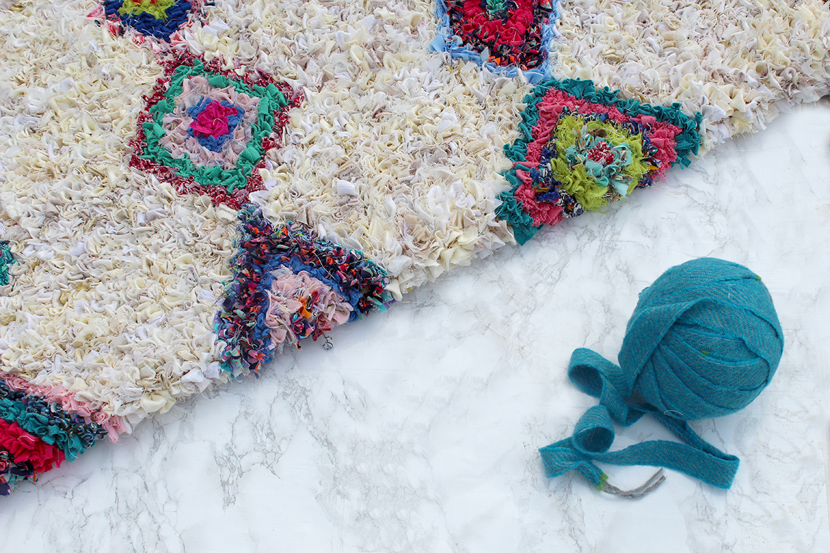 Moroccan style rag rug on marble floor