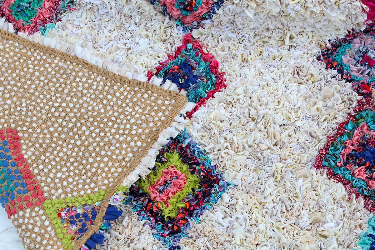The back of a Moroccan style berber rag rug on hessian