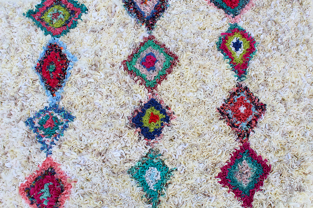 Diamond design rag rug in multicoloured old clothing and cream