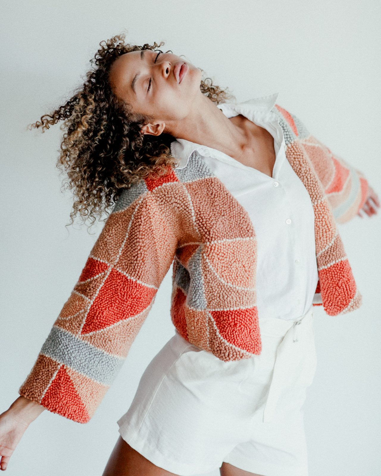 Micah Clasper- Torch Needle Punched Jacket Modelled Action Shot Pink Grey Beige