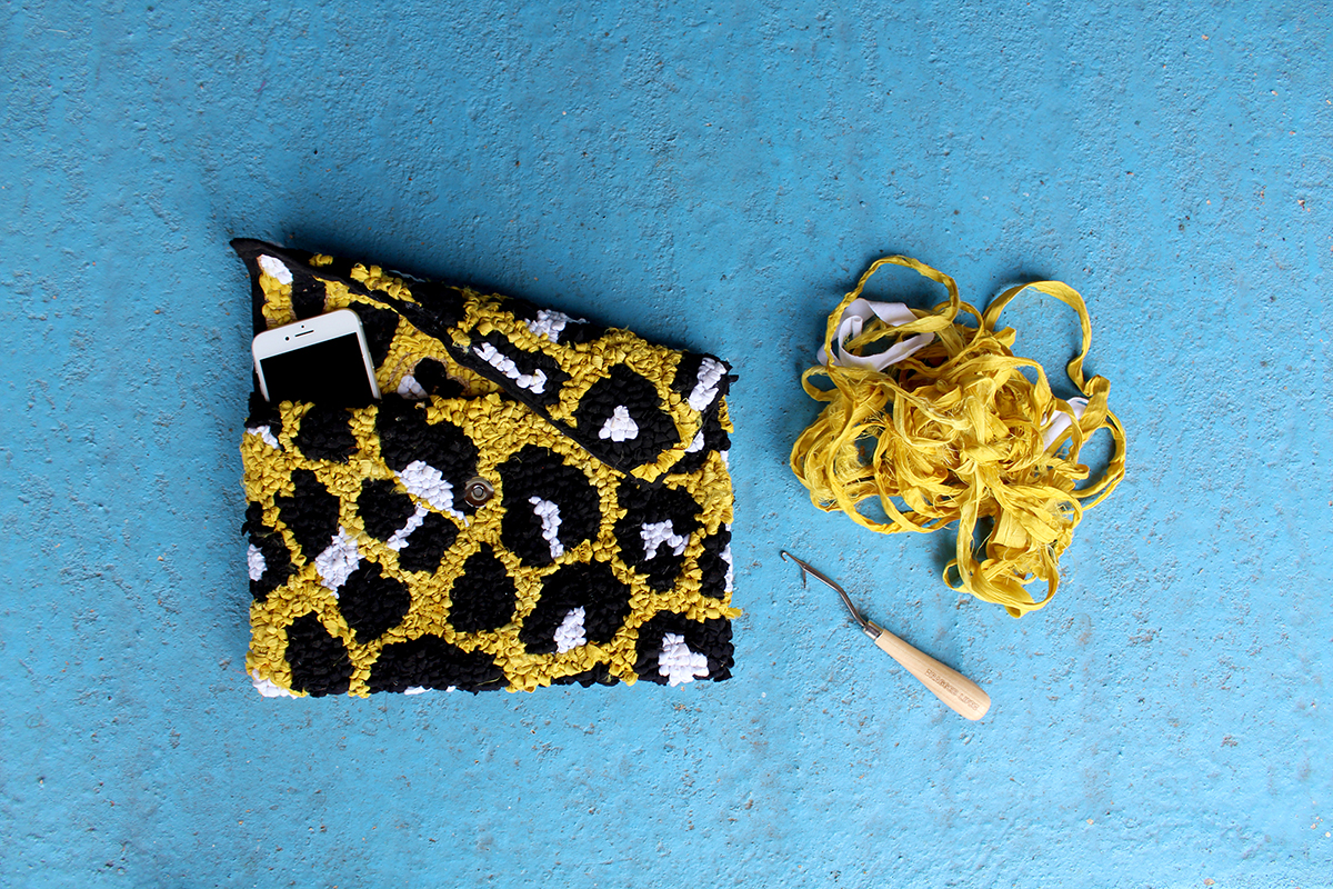 Yellow leopard print clutch bag made using fabric offcuts