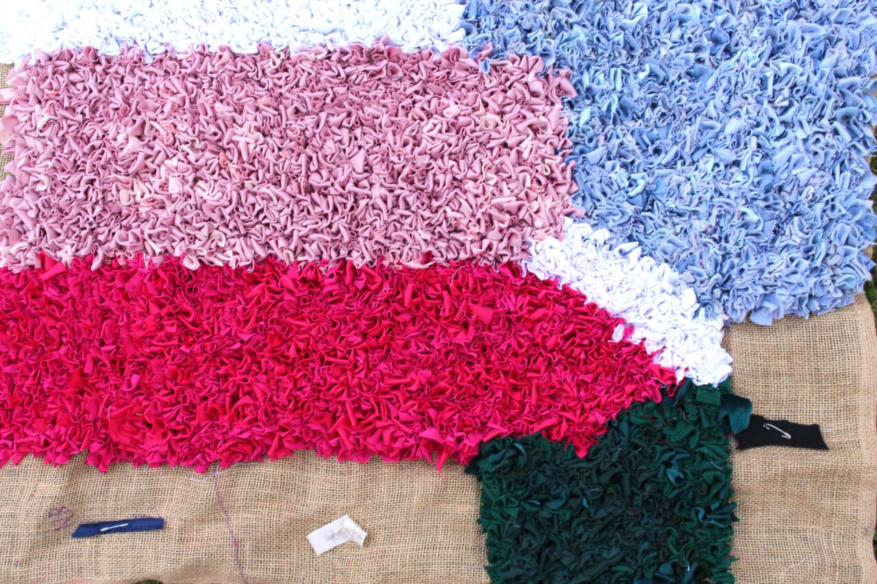 pink white green rag rug work in progress
