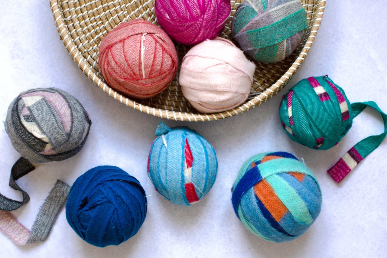 Balls of multicoloured blanket offcuts found in the Ragged Life Lucky Dip Pack