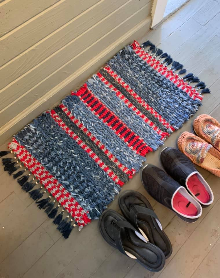 twined red blue rag rug with shoes