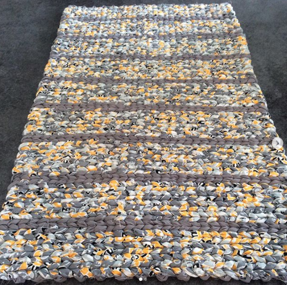 striped grey and yellow patterned fabric rag rug