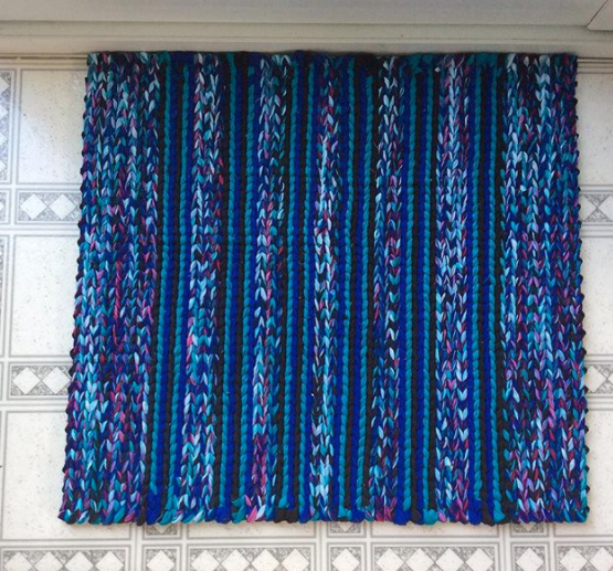 blue and purple patterned twined rag rug