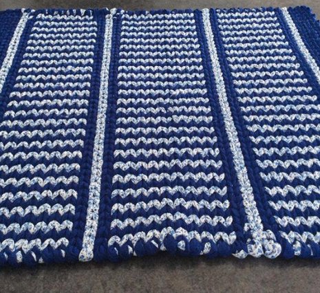 blue and white patterned twined rag rug