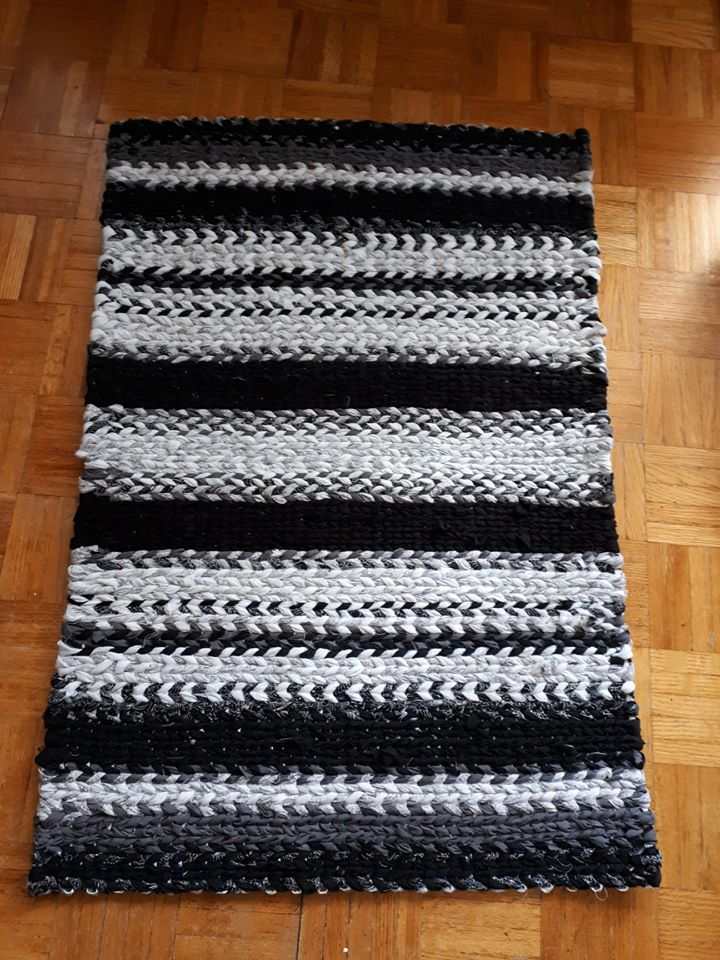striped black and white twined rag rug