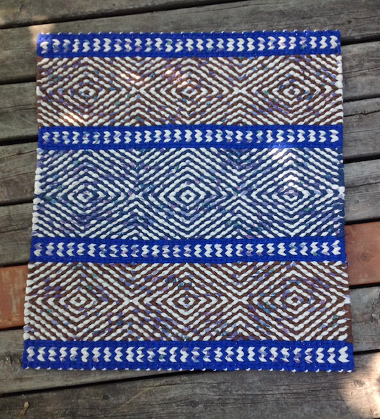 Patterned blue twined rag rug