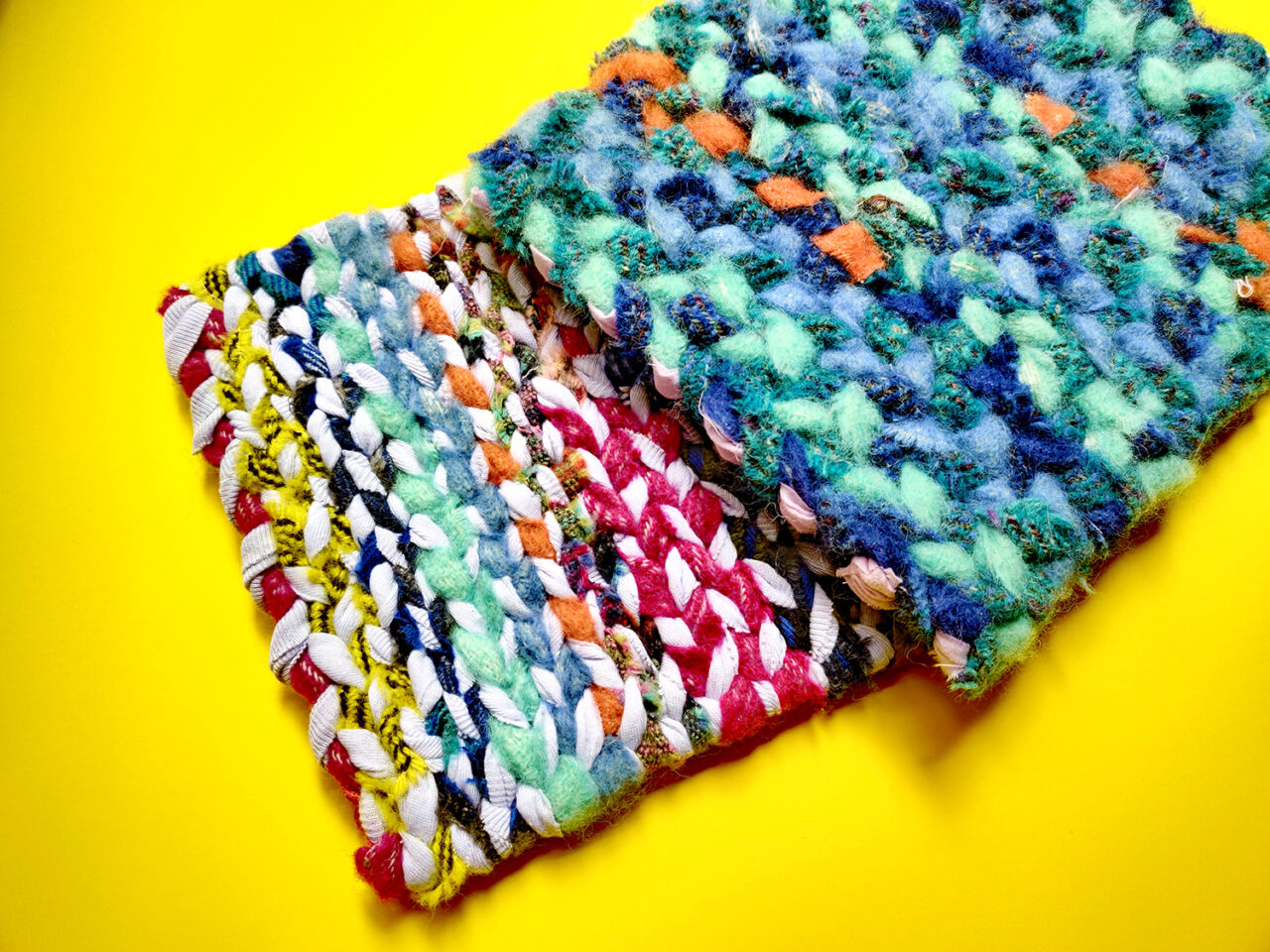 Colourful twined rug samplers made using mixed materials on a twining loom in the UK