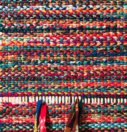 multicoloured patterned twined rag rug