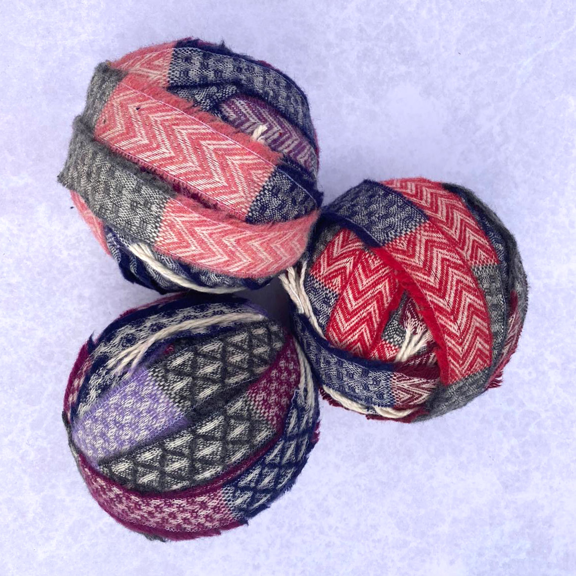Pink, red and purple striped chenille yarn