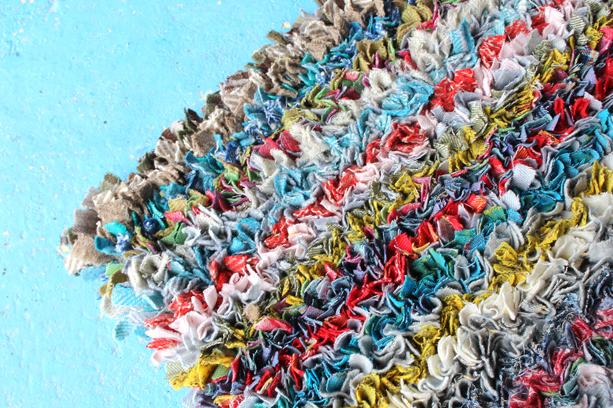 close up corner shot cosy cottage proggy colourful rag rug