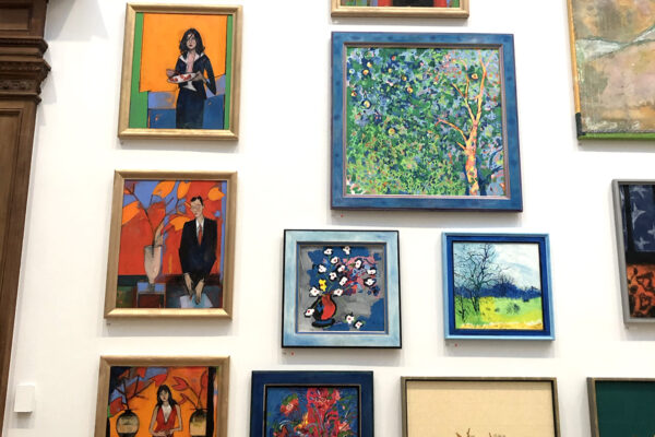 royal academy exhibition wall of colourful framed art work